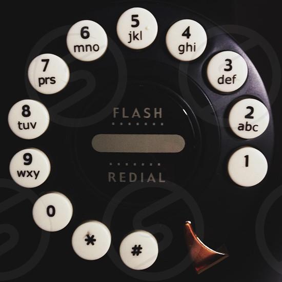 black and white rotary phone photo