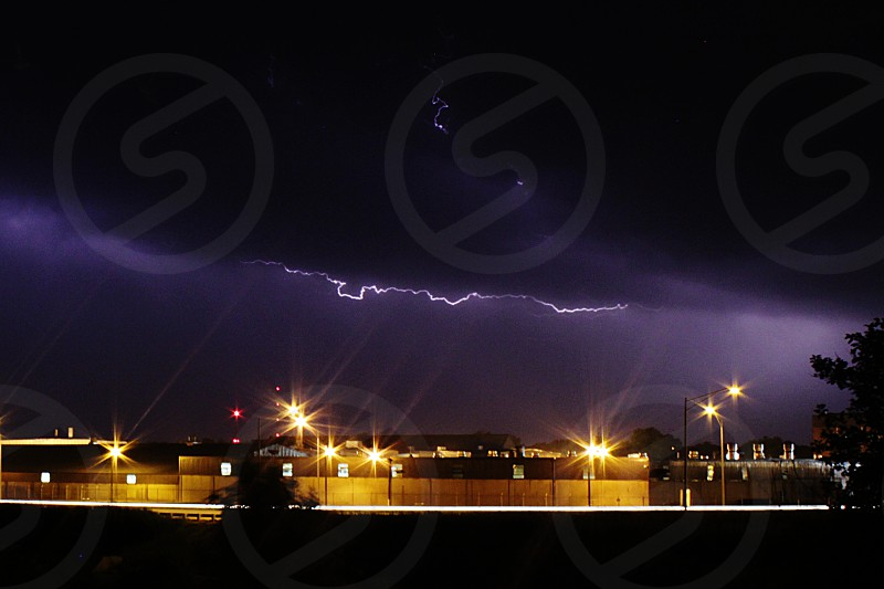 Lightning above a factory in the town where I live. photo