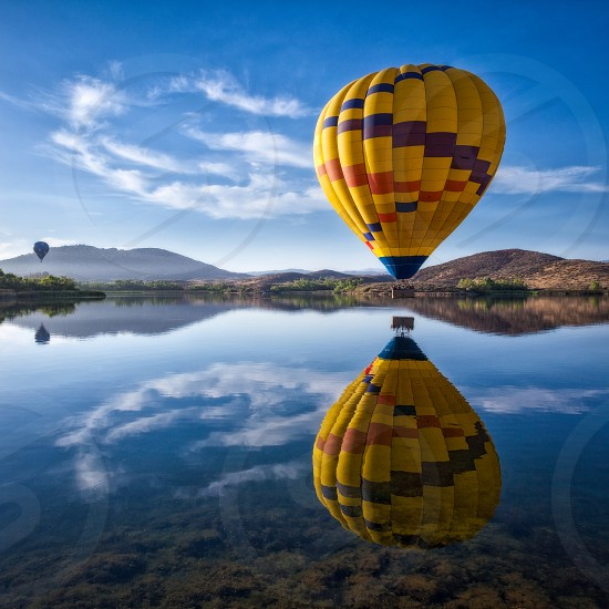 HOt air balloons over lake Skinner during the Temecula Balloon and Wine Festival photo