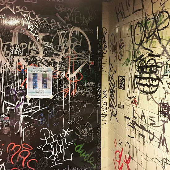 white black and orange vandalism on black and white wall photo