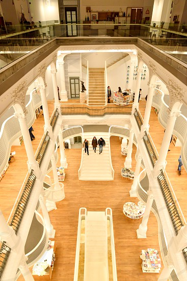 library book store building inside bucharest romania carusel carturesti people white stairs books photo