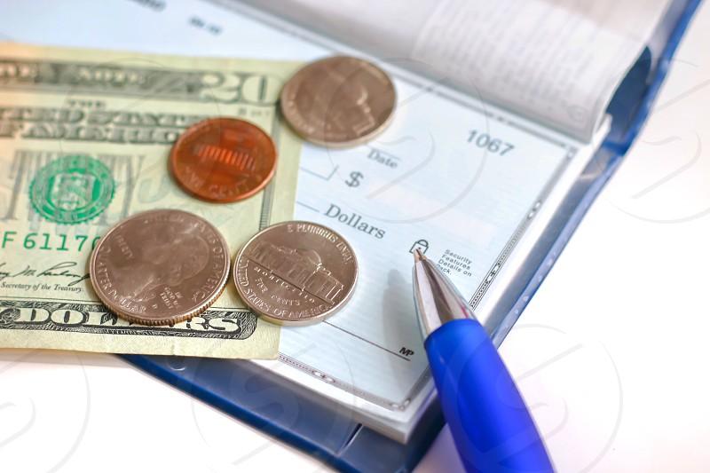 Money checkbook cash coins change pen check writing a check finance financial photo