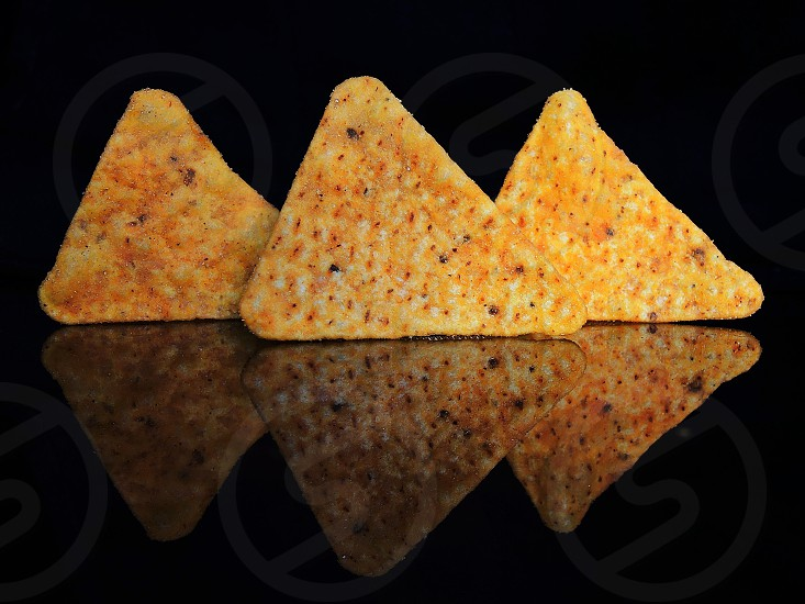 triangular fried food nuggets photo