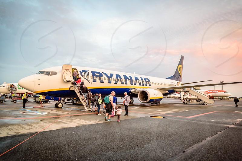 Passengers boarding a Ryanair Boeing B737 in Copenhagen airport. Near sunset photo