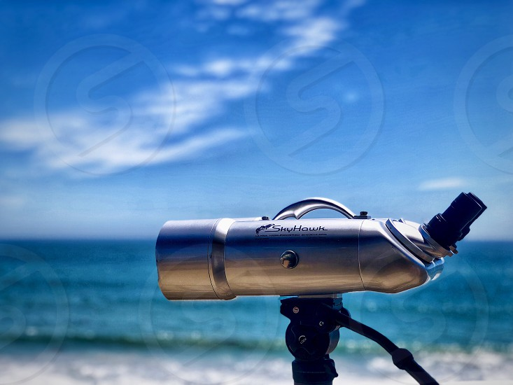 Five Senses Challenge Looking at the Ocean Through a Telescope on a Clear and Perfect Day so close you can smell taste hear and  feel the spray  photo