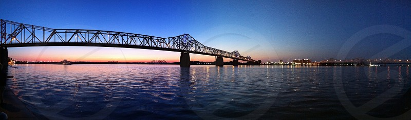 The Second Street (Clark) bridge crossing the Ohio River in Louisville Kentucky at dusk. photo
