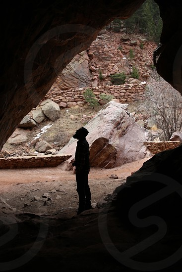Man in a cave photo
