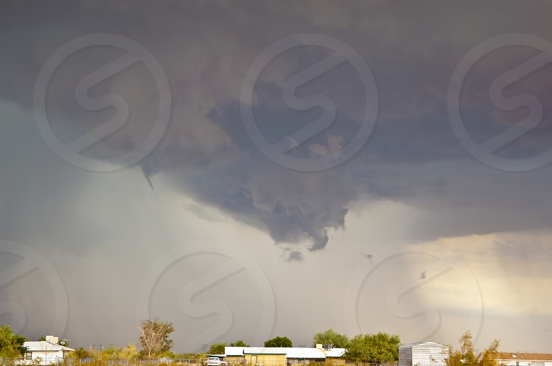 A very rare tornado funnel cloud over Tonopah Arizona. Taken in 2010. This particular tornado did destroy one mobile home and damaged several others. photo