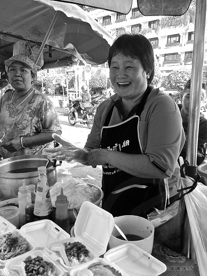 happy smiling labor day worker food worker Asian heritage street vendor photo
