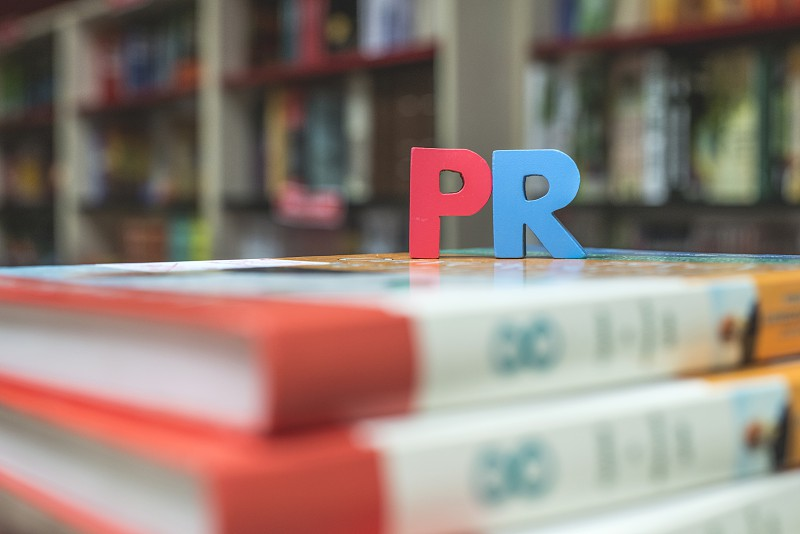 Word PR. Close up wooden letters. photo