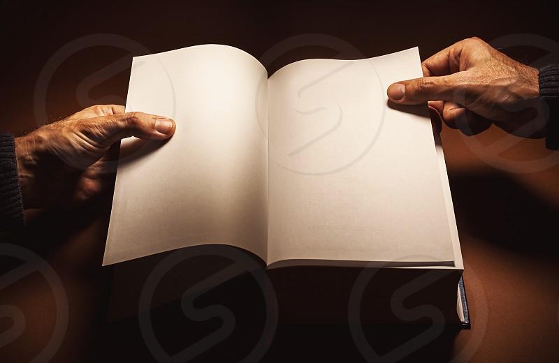 Conceptual composition about reading a book. photo