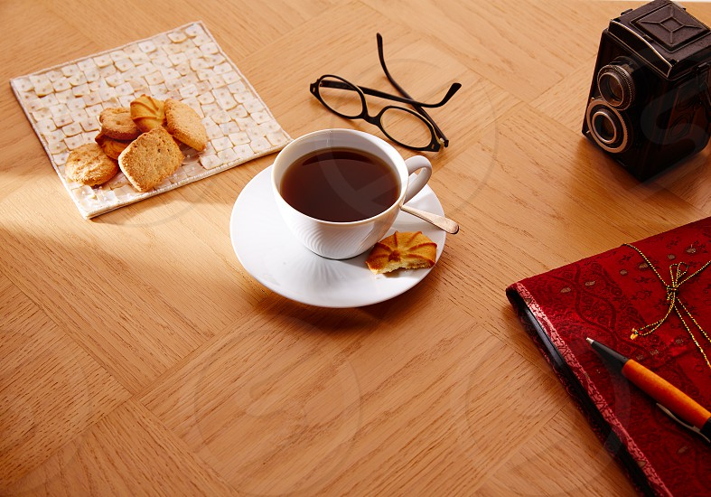 Morning breakfast coffee with vintage red notebook and biscuits photo