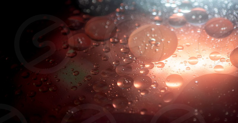 Oil in water bubbles abstract colorful background photo