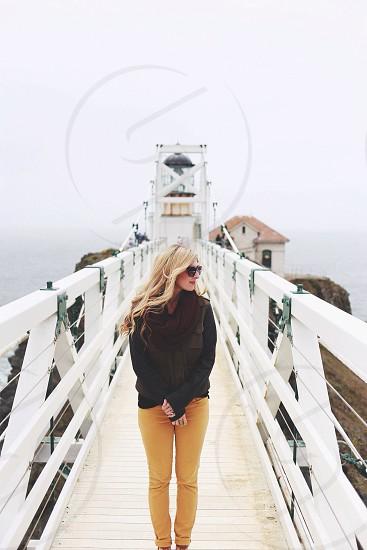 woman in black jacket walking photo