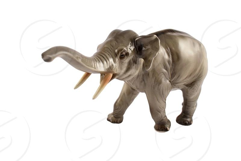 Realistic elephant statue. Figurine elephant. Elephant isolated on a white background photo