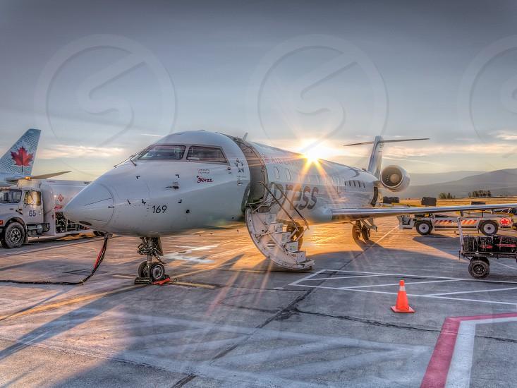 white private plane on airport photo
