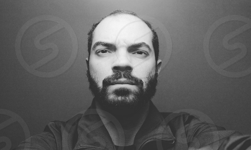 Serious man portrait in black and white photo