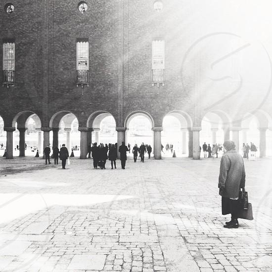 man in gray coat standing photo