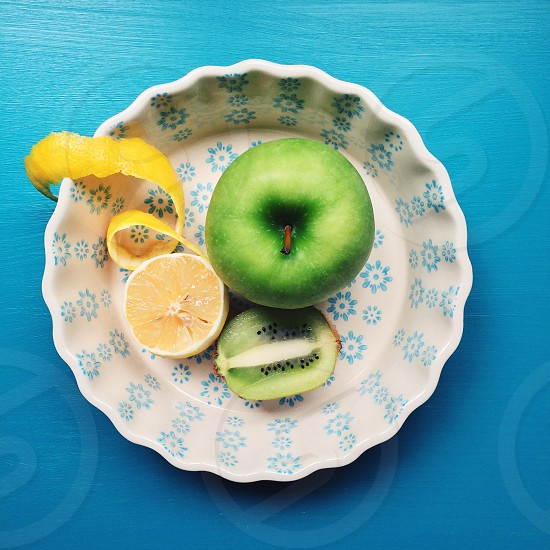 green apple on plate photo