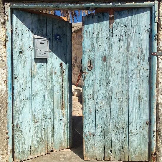 view of blue wooden door  with number 9 photo