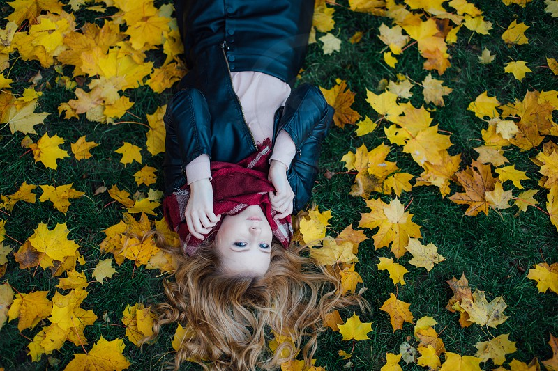 Girl autumn leafs smile happy face blond yellow photo