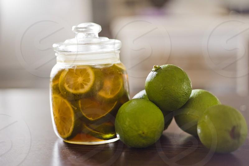 Close up of lime and lemon on a jar photo