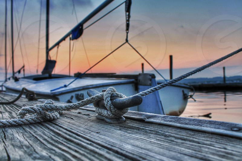 boat on dock view with rope tide on knot photo