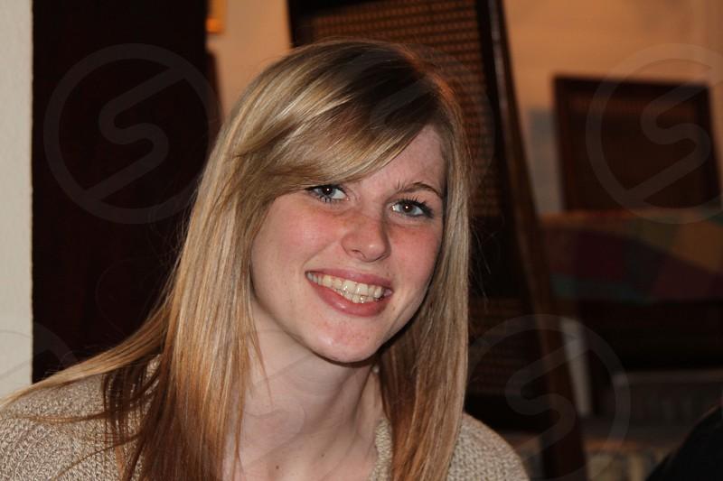 Blonde girl smiling photo