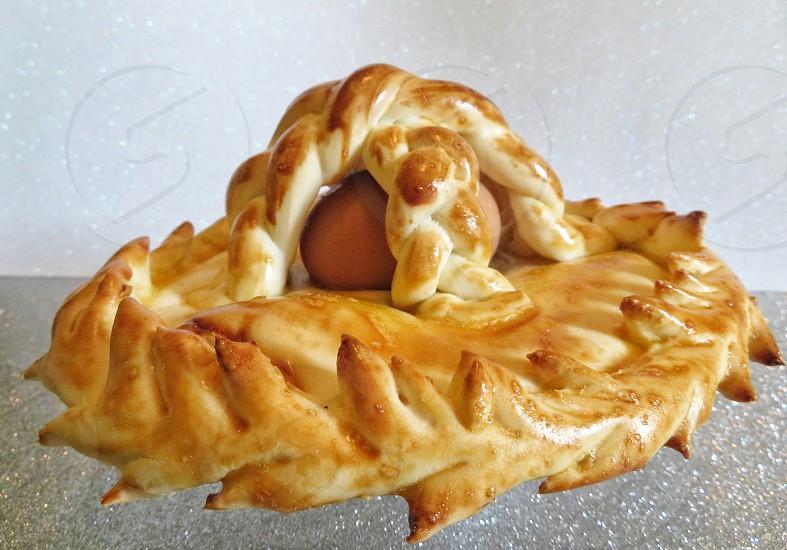 "traditional Sardinian Easter bread with entire egg. (""su coccoi cun s'oe"") Sardinia - Italy photo"