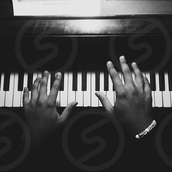 man playing piano grayscale photography  photo