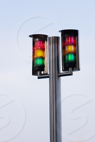 Twin warning light alarm on stainless pole for machines equipment on plain white background photo