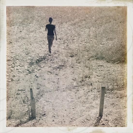 woman in a black shirt walking photo
