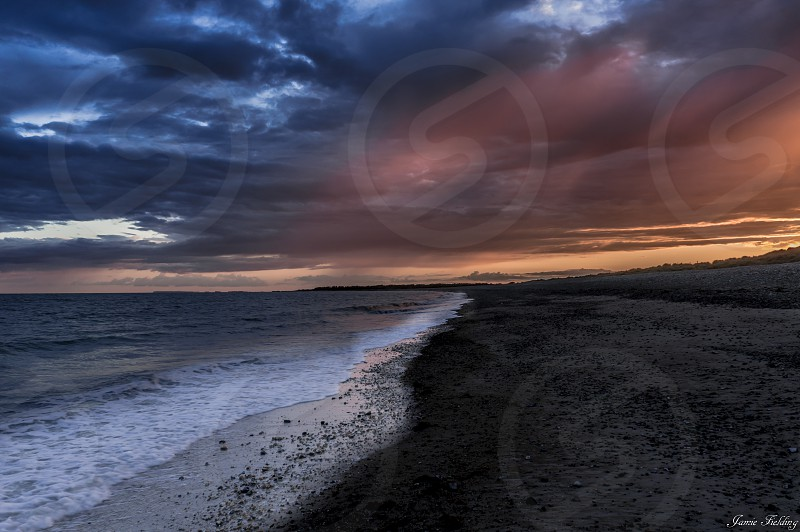 Sky colour clouds sunset red beach sand vibrant atmospheric evening photo
