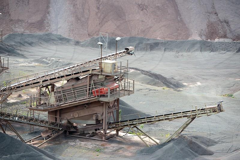 stone crusher machine in an open pit mine photo