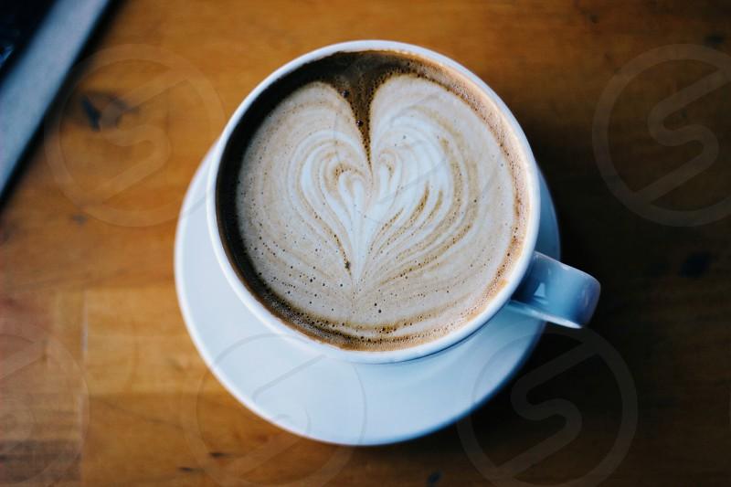 latte art in white ceramic mug photo