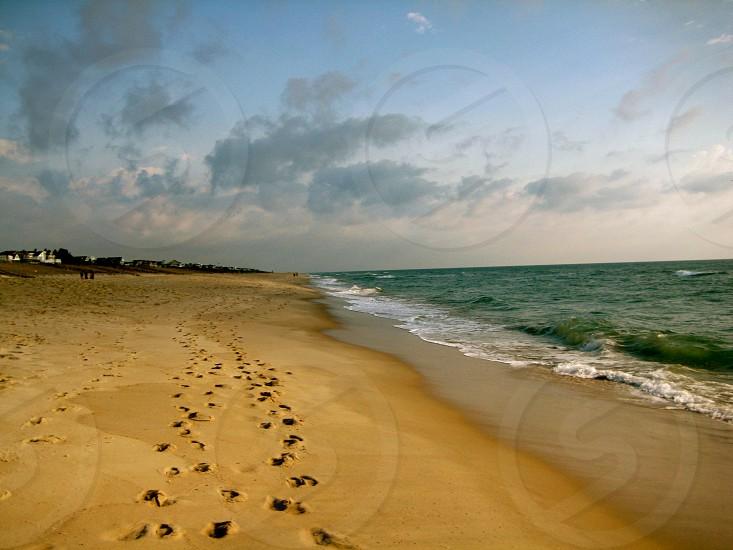 Beach walk coast water sand footprints waves photo