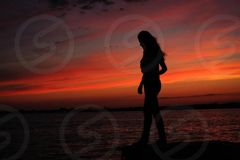 woman walking on the seashore photo