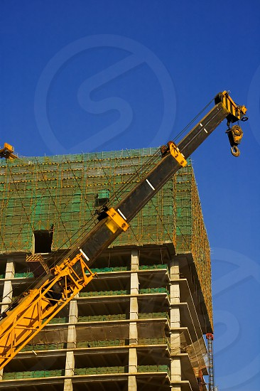 office skyscraper building on construction with big crane photo