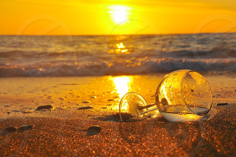 clear wine glass and sun rise photo