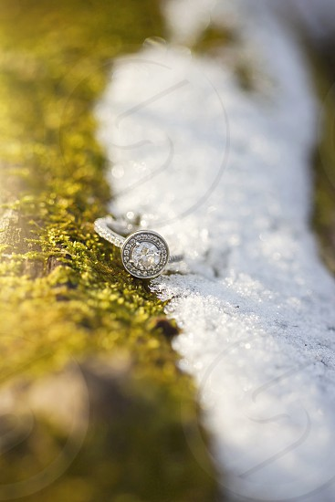 diamond studded silver ring on a white surface photo