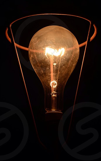 yellow lighted bulb photo