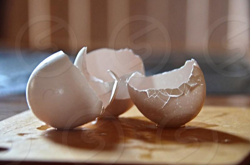 eggshells broke on brown wooden plank photo