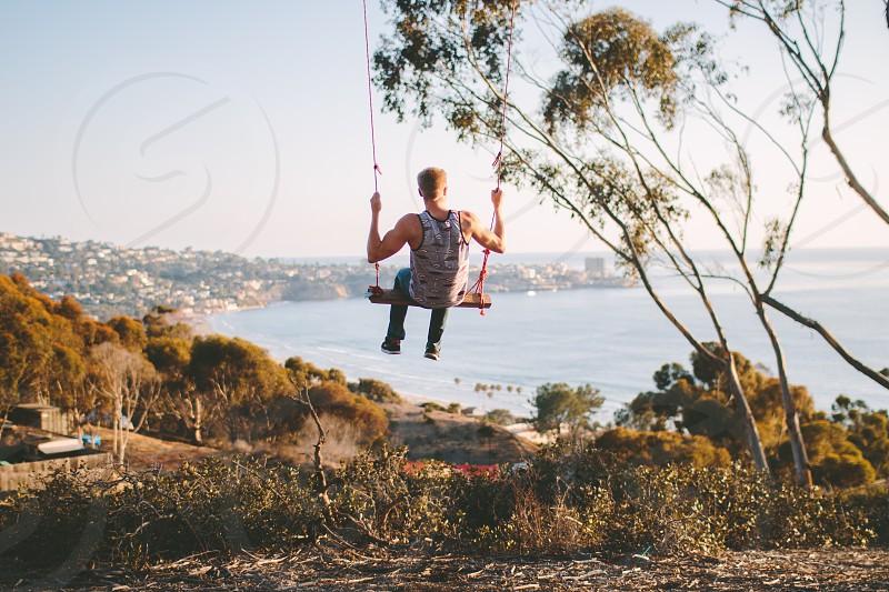 La Jolla CA. Secret swings adventure ocean California.  photo