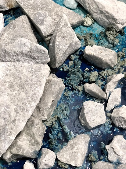Natural stones and turquoise-blue water. Beautiful combination. photo