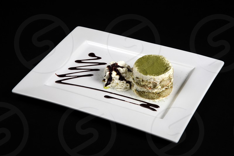 sweet green tea in white plate on a black background photo