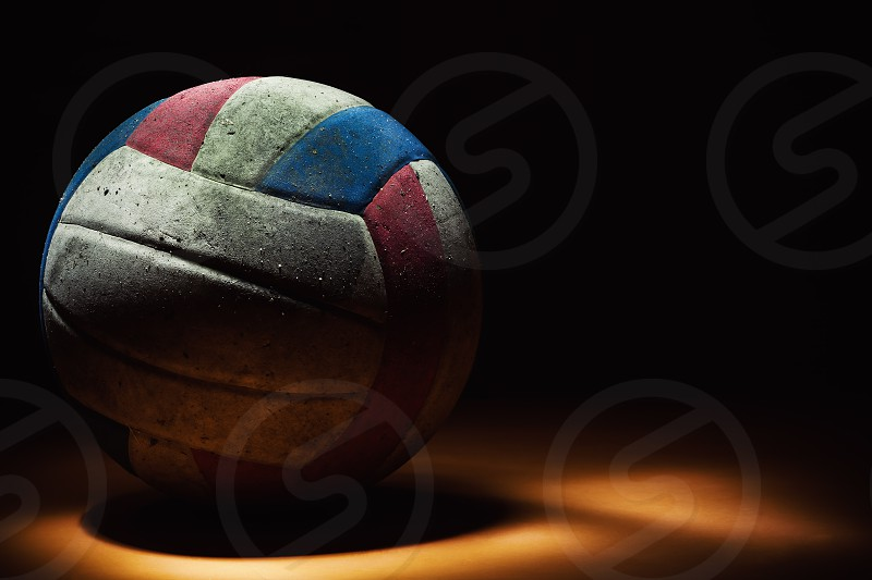 Closeup of an dirty volleyball colorful ball.  photo