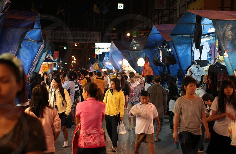 the night market in the city of Khorat in the Province of Nakhon Ratchasima in the Region of Isan in Northeast Thailand in Thailand.