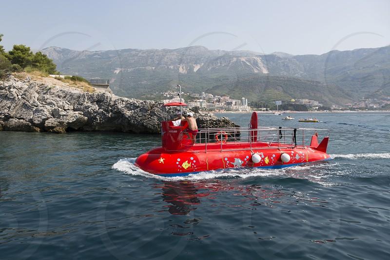 Pleasure boat in the form of a submarine off the coast of Budva Montenegro. photo