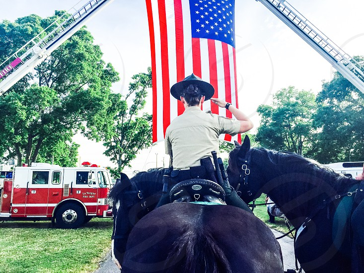 Police woman police officer horse black red firetruck American flag Stars & Stripes patriotic photo