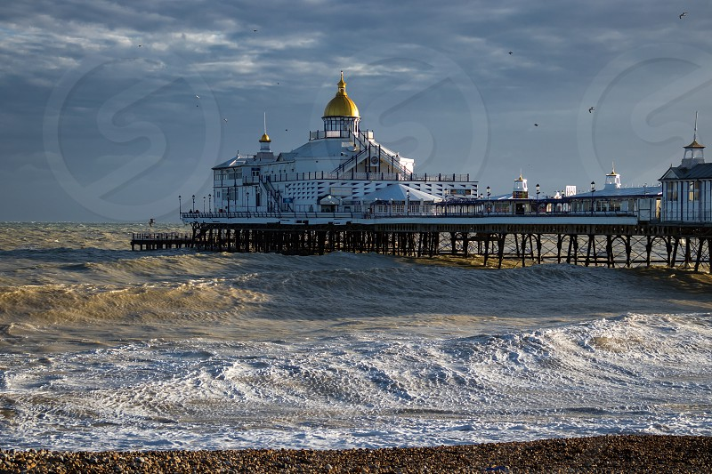 vEASTBOURNE EAST SUSSEX/UK - JANUARY 7 : View of Eastbourne Pier in East Sussex on January 7 2018. Unidentified people photo